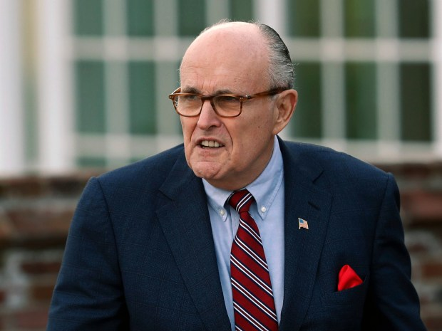 "FILE - In this Nov. 20, 2016 file photo, former New York Mayor Rudy Giuliani arrives at the Trump National Golf Club Bedminster clubhouse in Bedminster, N.J. President Donald Trump's new lawyer Rudy Giuliani said Wednesday, May 2, 2018, the president repaid attorney Michael Cohen for a $130,000 payment to porn star Stormy Daniels. Giuliani made the revelation during an appearance on Fox News Channel's ""Hannity."" (AP Photo/Carolyn Kaster, File)"