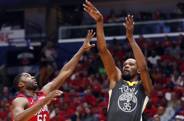 Golden State Warriors forward Kevin Durant (35) shoots over New Orleans Pelicans forward E'Twaun Moore (55) during the first half of Game 3 of a second-round NBA basketball playoff series in New Orleans, Friday, May 4, 2018. (AP Photo/Gerald Herbert)