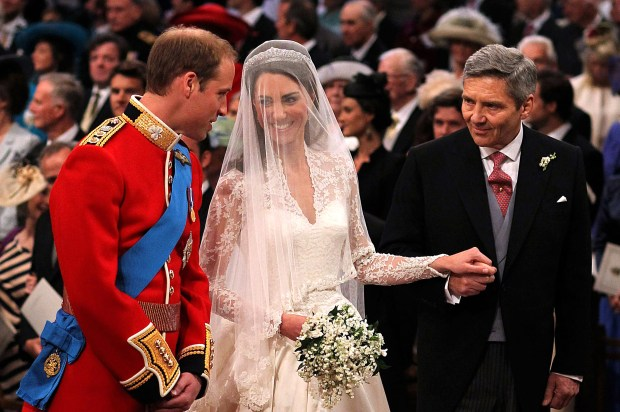 LONDON, ENGLAND - APRIL 29: Prince William speaks to his bride, Catherine Middleton as she holds the hand of her father Michael Middleton at Westminster Abbey on April 29, 2011 in London, England. The marriage of Prince William, the second in line to the British throne, to Catherine Middleton is being held in London today. The marriage of the second in line to the British throne is to be led by the Archbishop of Canterbury and will be attended by 1900 guests, including foreign Royal family members and heads of state. Thousands of well-wishers from around the world have also flocked to London to witness the spectacle and pageantry of the Royal Wedding. (Photo by Dominic Lipinski - WPA Pool/Getty Images)