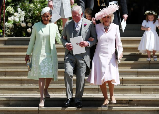 (L-R) Meghan Markle's mother Doria Ragland, Britain's Prince Charles, Prince of Wales (C) and Britain's Camilla, Duchess of Cornwall leave after the wedding ceremony of Britain's Prince Harry, Duke of Sussex and US actress Meghan Markle at St George's Chapel, Windsor Castle, in Windsor, on May 19, 2018. (Photo by Jane Barlow / POOL / AFP) (Photo credit should read JANE BARLOW/AFP/Getty Images)
