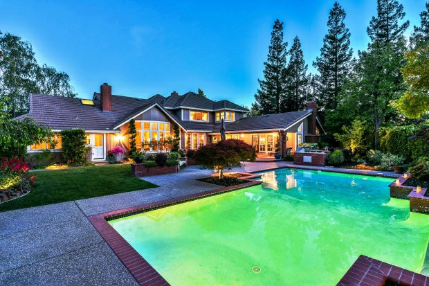 The home's backyard provides a lot of room to entertain on a grand scale or the ability to relax poolside.