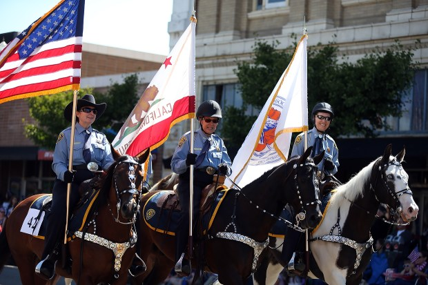 Members of the Alameda County Sheriff's Mounted Posse participate during the annual Mayor's Fourth of July Parade on Park Street in Alameda, Calif., on Monday, July 4, 2016. Alameda is one of the largest and longest Independence Day parades in the nation where more than 2,500 participants waved to an estimated 20,000 spectators along the three-mile route. The celebration started with the traditional 5-kilometer run and walk. (Ray Chavez/Bay Area News Group)