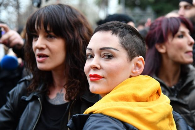 Italian actress Asia Argento (L) and US singer and actress Rose McGowan, who both accuse Harvey Weinstein of s****l assault, take part in a march organised by 'Non Una Di Meno' (Me too) movement on March 8, 2018 as part of the International Women's Day in Rome. 'Non Una Di Meno', which translates as Not One (Woman) Less, is the equivalent of the movement that grew out of the Harvey Weinstein-spurred s****l harassment and rape revelations. / AFP PHOTO / Alberto PIZZOLI (Photo credit should read ALBERTO PIZZOLI/AFP/Getty Images)