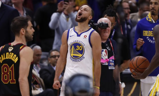 Golden State Warriors' Stephen Curry (30) celebrates following their 108-85 win against the Cleveland Cavaliers in Game 4 of the NBA Finals at Quicken Loans Arena in Cleveland, Ohio, on Friday, June 8, 2018. (Nhat V. Meyer/Bay Area News Group)