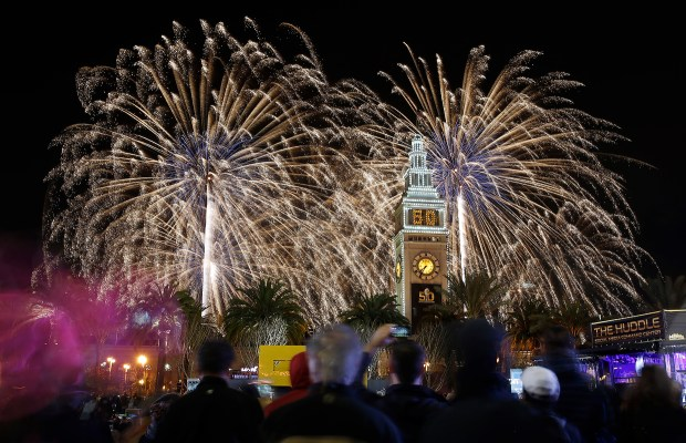 Crowds watch as fireworks explode behind the Ferry Building at Super Bowl City in San Francisco, Calif., on Saturday, Jan. 30, 2016. (Jim Gensheimer/Bay Area News Group)