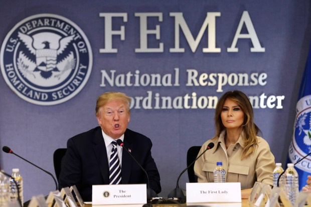 WASHINGTON, DC - JUNE 6: (AFP OUT) U.S. President Donald Trump speaks alongside First Lady Melania Trump at the 2018 Hurricane Briefing at the Federal Emergency Management Agency Headquarters (FEMA) on June 6, 2018 in Washington, DC. (Photo by Yuri Gripas - Pool/Getty Images)