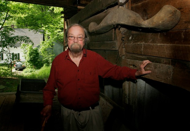 FILE - In this June 13, 2006, file photo, Donald Hall, author of numerous poetry books, poses in the barn of the 200-year-old Wilmot farm that has been in his family for four generations. Hall, a prolific, award-winning poet and man of letters widely admired for his sharp humor and painful candor about nature, mortality, baseball and the distant past, died at age 89. Hall's daughter, Philippa Smith, confirmed Sunday, June 24, 2018, that her father died Saturday at his home in Wilmot, after being in hospice care for some time. (AP Photo/Jim Cole, File)