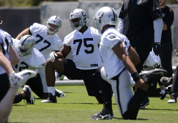 Oakland Raiders rookie tackle Brandon Parker (75) stretches during mini-camp. (AP Photo/Rich Pedroncelli)