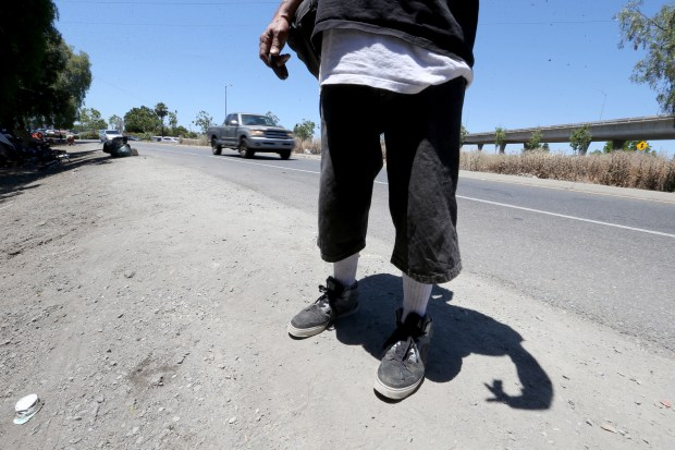 A homeless man who identified as Rudy talks about the homeless situation on Story Road onramp to southbound US 101 in San Jose, Calif., on Friday, June 22, 2018. Earlier, San Jose city councilman Tam Nguyen hosted a press conference in which he took Caltrans to task for not addressing the new and grown homeless encampment. (Ray Chavez/Bay Area News Group)