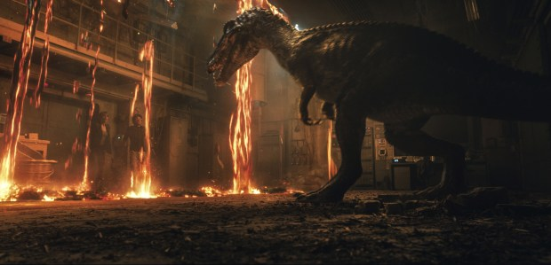 "This image released by Universal Pictures shows Bryce Dallas Howard, left, and Justice Smith in a scene from the upcoming ""Jurassic World: Fallen Kingdom."" (Universal Pictures via AP)"