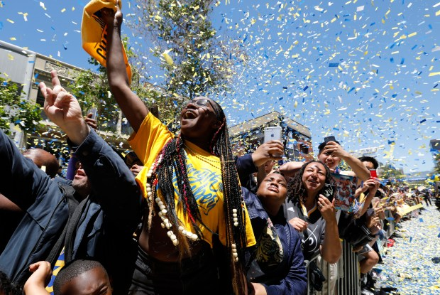 Fans cheer as confetti falls during the Warriors Championship parade in Oakland, Calif., on Tuesday. June 12, 2018. (Laura A. Oda/Bay Area News Group)