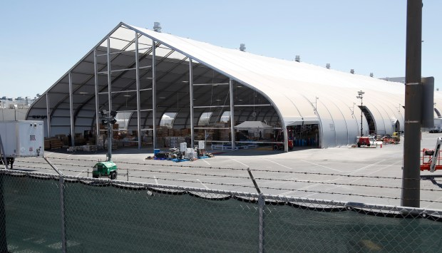 A large tent behind the Tesla factory Calif., on Monday, June 25, 2018. The tent is being used to build the Model 3 cars. (Nhat V. Meyer/Bay Area News Group)