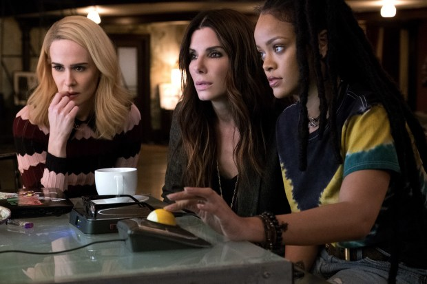 "This image released by Warner Bros. shows Sarah Paulson, from left, Sandra Bullock and Rihanna in a scene from ""Ocean's 8."" (Barry Wetcher/Warner Bros. via AP)"