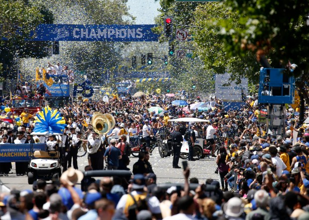 Broadway in downtown Oakland is a sea of confetti and humanity as the Golden State Warriors are honored for their third NBA championship in the past four years, Tuesday, June 12, 2018, in Oakland, Calif. (Karl Mondon/Bay Area News Group)
