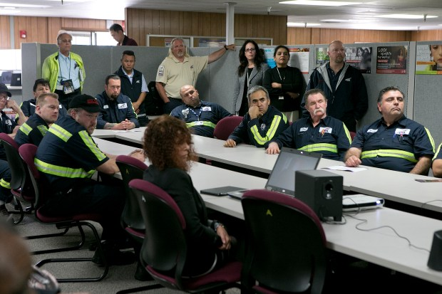 Valley Transportation Authority (VTA) bus division employees watch a training video to help VTA employees identify and report human trafficking at the VTA Cerone Bus Division facility in San Jose, Calif., on Tuesday, March 24, 2015. (LiPo Ching/Bay Area News Group)