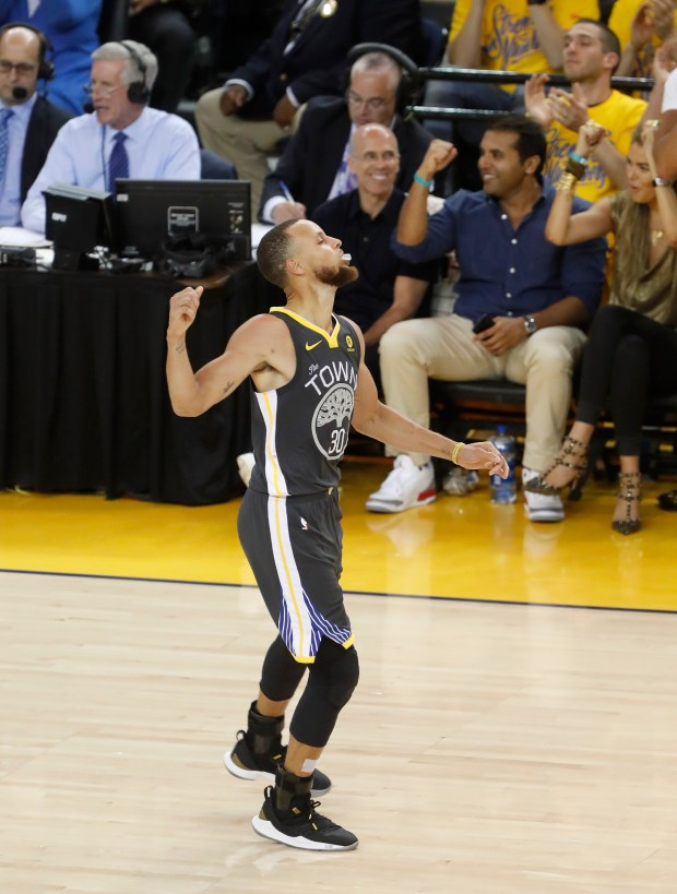 Golden State Warriors' Stephen Curry (30) celebrates his 3-point basket against the Cleveland Cavaliers in the fourth quarter of Game 2 of the NBA Finals at Oracle Arena in Oakland, Calif., on Sunday, June 3, 2018. (Nhat V. Meyer/Bay Area News Group)