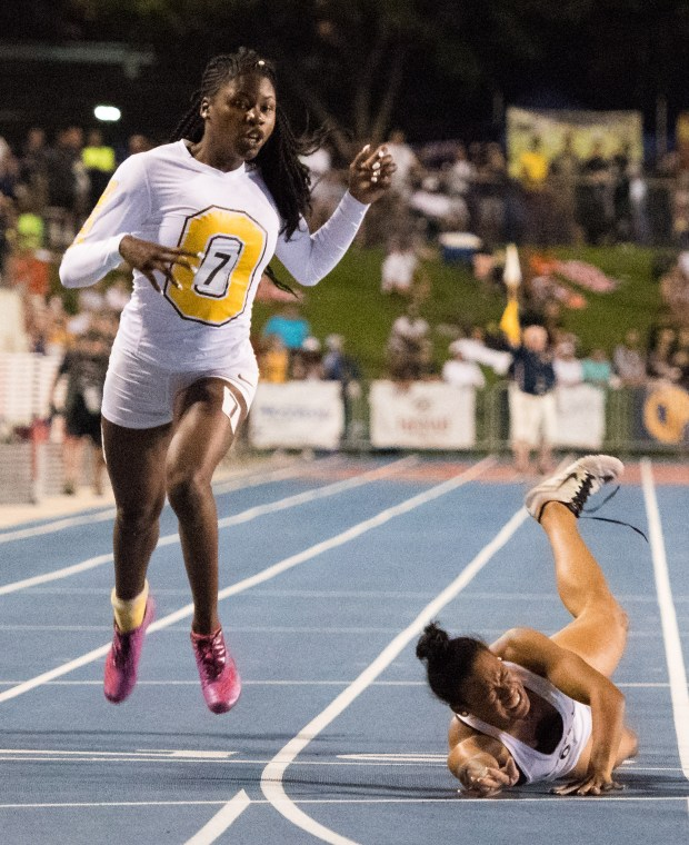 Bishop O'Dowd's Tierra Robinson-Jones crosses the line in first as Long Beach Poly's Ariyonna Augustine falls across the line in the girls 200-meter dash during the finals of the CIF State Track and Field Championships at Veterans Memorial Stadium on Buchanan High School campus on Saturday, June 2, 2018 in Clovis, Calif. (Photo by Josh Barber, Contributing Photographer)