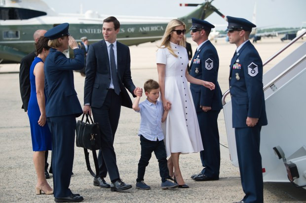 White House Senior Advisers Jared Kushner and Ivanka Trump walk to Air Force One with their children prior to departure from Joint Base Andrews in Maryland, June 29, 2018, as US President Donald Trump travels to Bedminster, New Jersey for the weekend. (Photo by SAUL LOEB / AFP) (Photo credit should read SAUL LOEB/AFP/Getty Images)