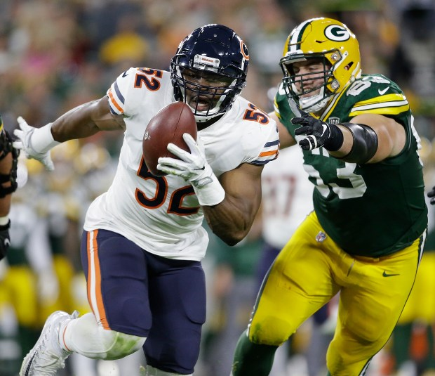 Chicago Bears  Khalil Mack intercepts a pass and returns it for a touchdown  during the first half of an NFL football game against the Green Bay Packers  ... bc50c9cb4