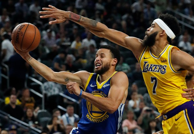 Golden State Warriors guard Stephen Curry shoots around Los Angeles Lakers  center JaVale McGee during the second half of an NBA preseason basketball  game ... 6769f91f9