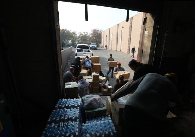 CHICO CALIFORNIA NOVEMBER 18 With Rains Expected Later This Week Volunteers Hustle Donated Supplies For Camp Fire Victims Into A Vacant Toys R Us