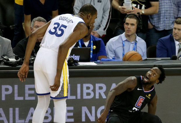 ad7b97cb77c Golden State Warriors  Kevin Durant (35) looks on Los Angeles Clippers  Patrick  Beverley (21) after he was fouled by Durant during the fourth quarter of ...