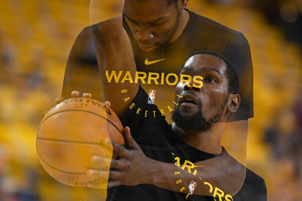d8a5e81f46d2 (Double exposure created in camera) Golden State Warriors  Kevin Durant  (35) shoots while warming up before the start of Game 2 of their NBA second  round ...