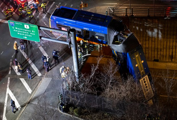 New York City bus crashes off overpass; passengers left dangling