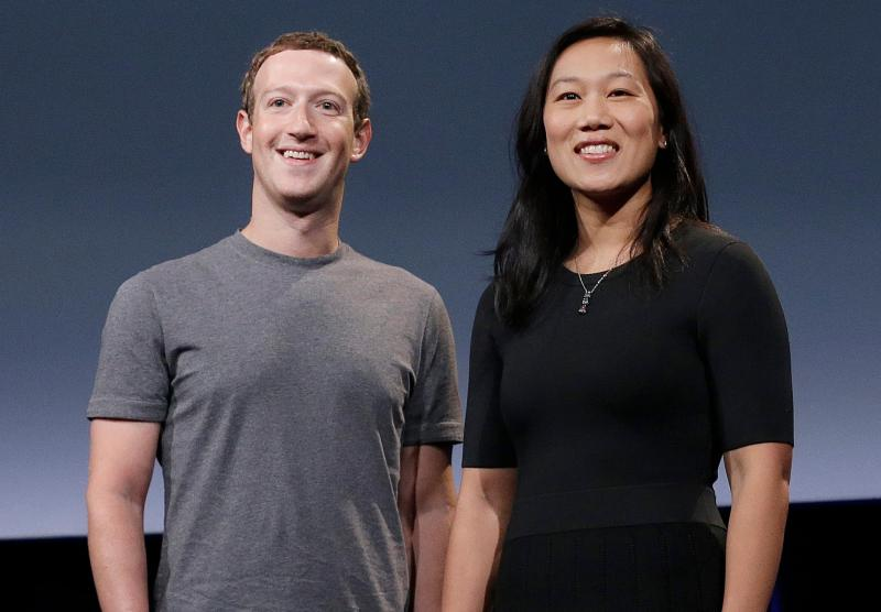 """FILE – In this Sept. 20, 2016, file photo, Facebook CEO Mark Zuckerberg and his wife, Priscilla Chan, smile as they prepare for a speech in San Francisco. A group of more than two dozen philanthropic organizations and corporations on Thursday, Feb. 4, 2021, announced the """"California Black Freedom Fund."""" It's five-year $100 million initiative the group says will provide resources to Black-led organizations in the state aiming to eradicate systemic racism. The 25 funders include the philanthropic groups of Facebook CEO Mark Zuckerberg and his wife, Priscilla Chan, Philanthropist Laurene Powell Jobs as well as JPMorgan Chase. (AP Photo/Jeff Chiu, File)"""