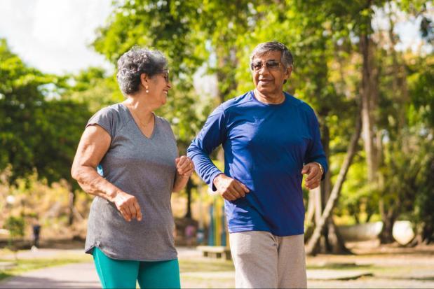 Senior Hispanic Couple Power Walking Outdoors