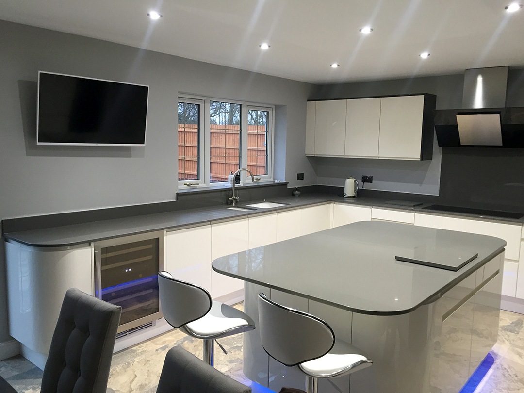 Second Nature handleless fitted kitchen. Designed and installed by Meridien Interiors