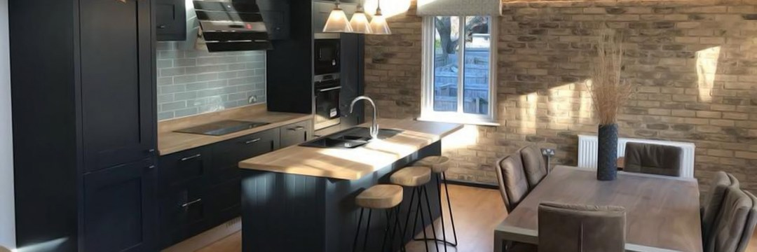 Charcoal coloured Milbourne Shaker kitchen by Second Nature. Installed in property in Poole, Dorset