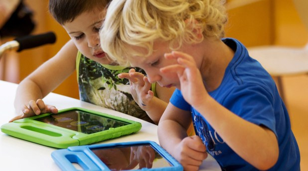 Students play with their ipads
