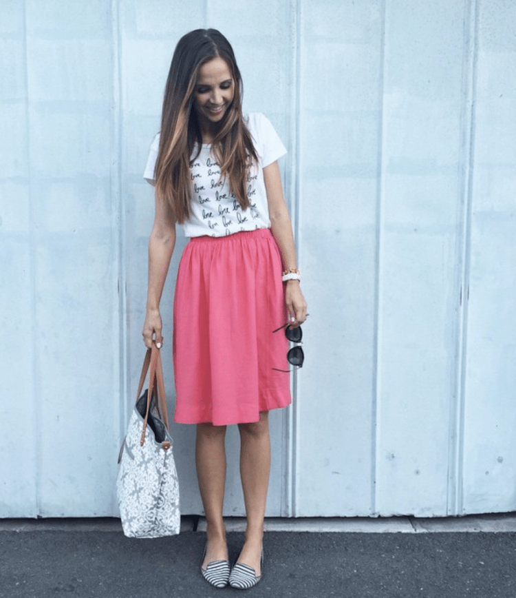 pink skirt and graphic tee