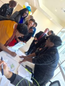 Congresswoman Lee waits her turn to sign in at registration with Doris Hankins of the VPI's Office.