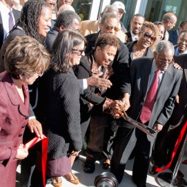 Congresswoman Barbara Lee cuts the ribbon marking the grand opening of the building in her name.