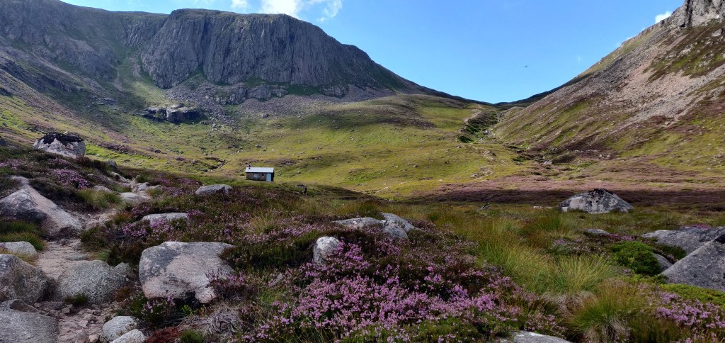 The Hutchison Memorial Hut with the lip into Coire Etchachan behind