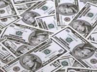Dolarul va atinge noi maxime în 2016