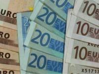 Euro a scăzut cu mai mult de un ban