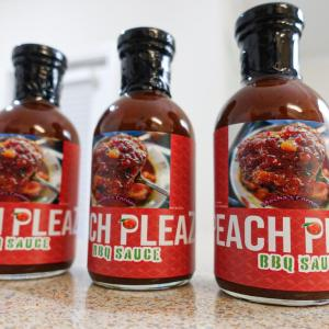 3 bottles of Peach Pleaz standing in a row