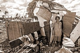 Hurricane woman in make shift house