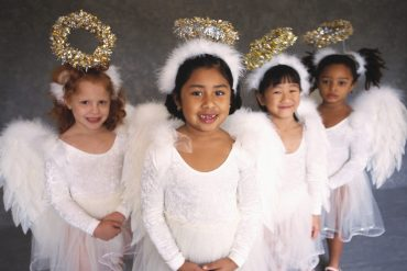 Little girls in angel costumes
