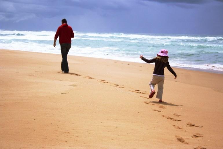 girl following dad