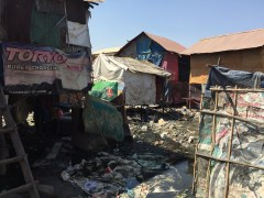 This is one of the neighborhoods we visited in the slums of Pnomh Penh.  In rainy season the water will flow beneath all of these homes.  It is very unhealthy here!