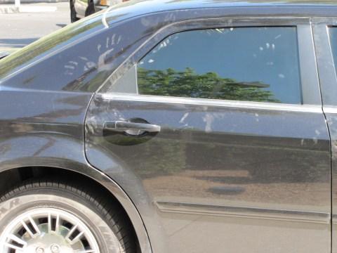 black Chrysler 300 handprints
