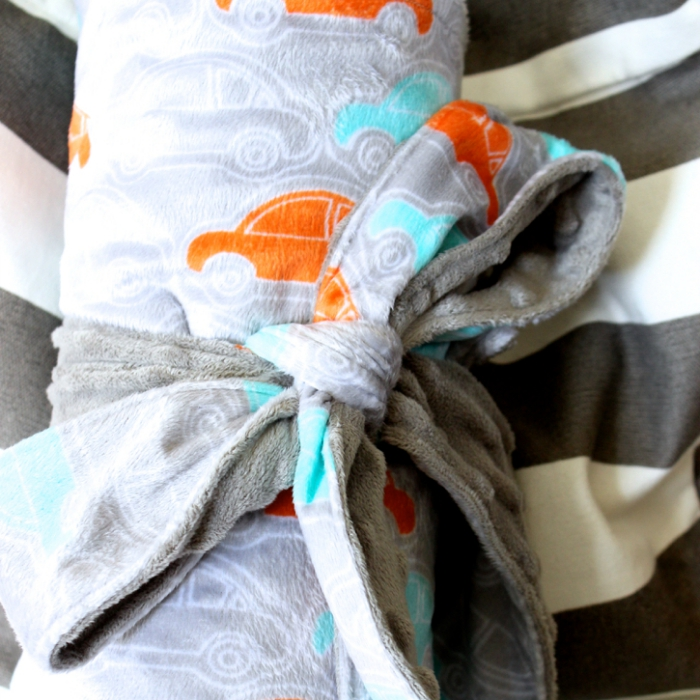 This baby blanket rolls up and is ready to go! It fits nicely in a diaper bag!!