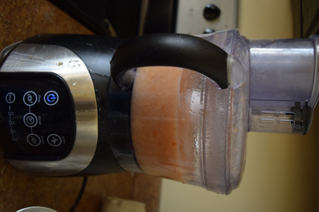 Pureed peaches in food processor