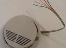 How do you change the battery in your smoke detectors with cable connection