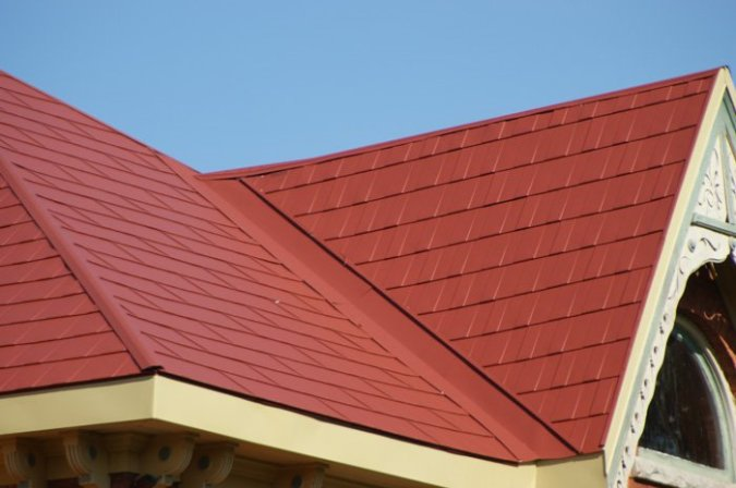 A closeup of red metal steel shingles from Metal Roof Outlet