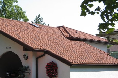 This Ontario home features a steel tile roof from Metal Roof Outlet.